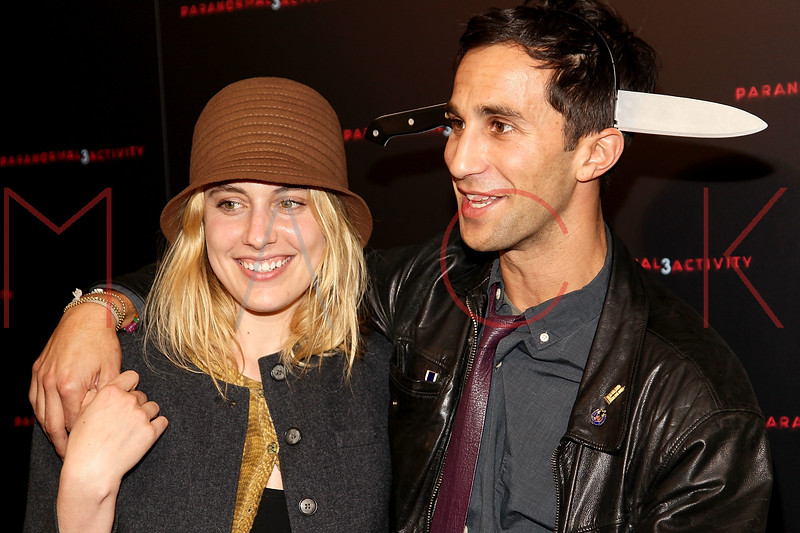 """NEW YORK, NY - OCTOBER 18:  Greta Gerwig and Co-director Ariel Schulman attend the """"Paranormal Activity 3"""" super-fan screening at the Regal Union Square Theatre, Stadium 14 on October 18, 2011 in New York City.  (Photo by Steve Mack/S.D. Mack Pictures) *** Local Caption *** Greta Gerwig; Ariel Schulman"""