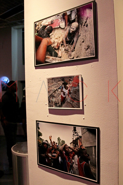 NEW YORK, NY - SEPTEMBER 28:  Atmosphere (photography by Daniel Morel) at a Night of Art Music to benefit Haiti at the Red Bull Space on September 28, 2011 in New York City.  (Photo by Steve Mack/S.D. Mack Pictures)