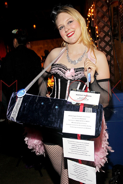 NEW YORK, NY - SEPTEMBER 29:  A cigarette girl poses at the Teaser Party kick off during the 9th annual New York Burlesque Festival at The Bell House on September 29, 2011 in the Brooklyn borough of New York City.  (Photo by Steve Mack/S.D. Mack Pictures)