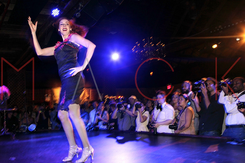 NEW YORK, NY - SEPTEMBER 29:  A burlesque dancer goes through her routine at the Teaser Party kick off during the 9th annual New York Burlesque Festival at The Bell House on September 29, 2011 in the Brooklyn borough of New York City.  (Photo by Steve Mack/S.D. Mack Pictures)