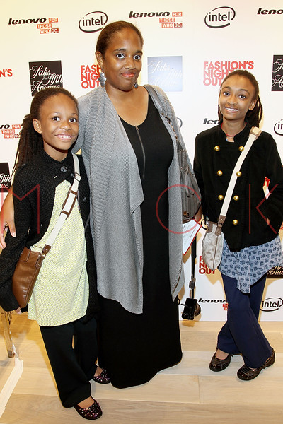 NEW YORK, NY - SEPTEMBER 08:  Aila James, Jennifer James and Annlyel James at Saks Fifth Avenue on September 8, 2011 in New York City.  (Photo by Steve Mack/Getty Images for Vogue) *** Local Caption *** Aila James; Jennifer James and Annlyel James