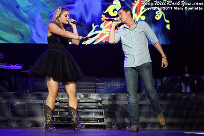 Scotty McCreery and Lauren Alaina perform at American Idols Live! at the DCU Center on September 1, 2011 in Worcester, Massachusetts