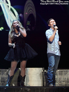 Scotty McCreery (L) and Lauren Alaina perform at American Idols Live! at the DCU Center on September 1, 2011 in Worcester, Massachusetts
