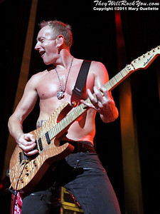 """Phil Collen of Def Leppard performs on June 30, 2011 during the """"Mirrorball Tour"""" at the Comcast Center in Mansfield, Massachusetts."""