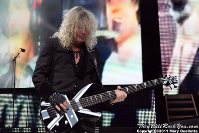 "Rick Savage of Def Leppard performs on June 30, 2011 during the ""Mirrorball Tour"" at the Comcast Center in Mansfield, Massachusetts."