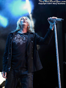 """Joe Elliott of Def Leppard performs on June 30, 2011 during the """"Mirrorball Tour"""" at the Comcast Center in Mansfield, Massachusetts."""