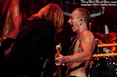 Sep 10, 2011, Irvine, CA, USA - Phil Collen and Joe Elliott of Def Leppard, perform in support of the bands latest release Mirror Ball at the Verizon Wireless Amphitheater for the 6th annual 93.1 Jack FM show.
