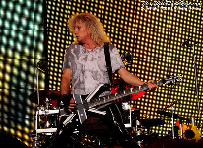 Sep 10, 2011, Irvine, CA, USA - Rick Savage bass player for Def Leppard, performs in support of the bands latest release Mirror Ball at the Verizon Wireless Amphitheater for the 6th annual 93.1 Jack FM show.