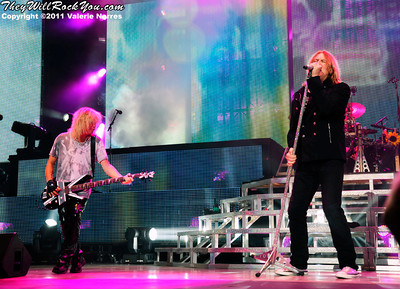 Sep 10, 2011, Irvine, CA, USA - Rick Savage and Joe Elliott of Def Leppard, perform in support of the bands latest release Mirror Ball at the Verizon Wireless Amphitheater for the 6th annual 93.1 Jack FM show.