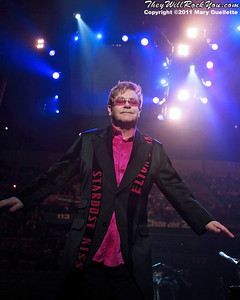 Elton John and his band perform on March 12, 2011 at the DCU Center in Worcester, Massachusetts