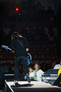Dave Grohl's wife and baby sitting stageside