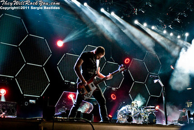 Muse performing live on the stage of LA Rising in Los Angeles, Calif. on July 30th, 2011. (Photo by Sergio Bastidas/sini69photo.com, ©2011)