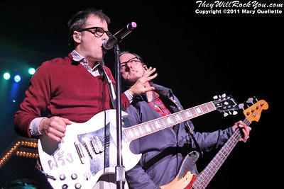 """Rivers Cuomo and Scott G. Shriner of Weezer perform on May 19, 2011  in support of """"Hurley"""" at the Bank of America Pavilion in Boston, Massachusetts"""