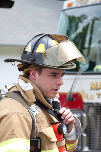 Rochelle Park Captain Pete Donatello gives a progress report after exiting the fire building.