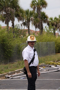 Lake County Fire/Rescue Battalion Chief Jones oversees operations in the rear of the complex.