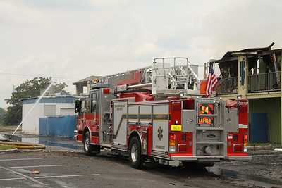 Osceola County Fire/Rescue Ladder Co. 54 relocates to the rear of the complex to operate,
