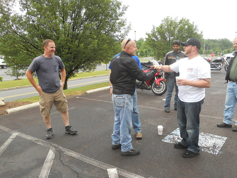 Rob Hatfield, Ricky Adams and other bystanders. Rob and I were both on the planning committee for Martin Motorsports Modern Classic Bike Show!