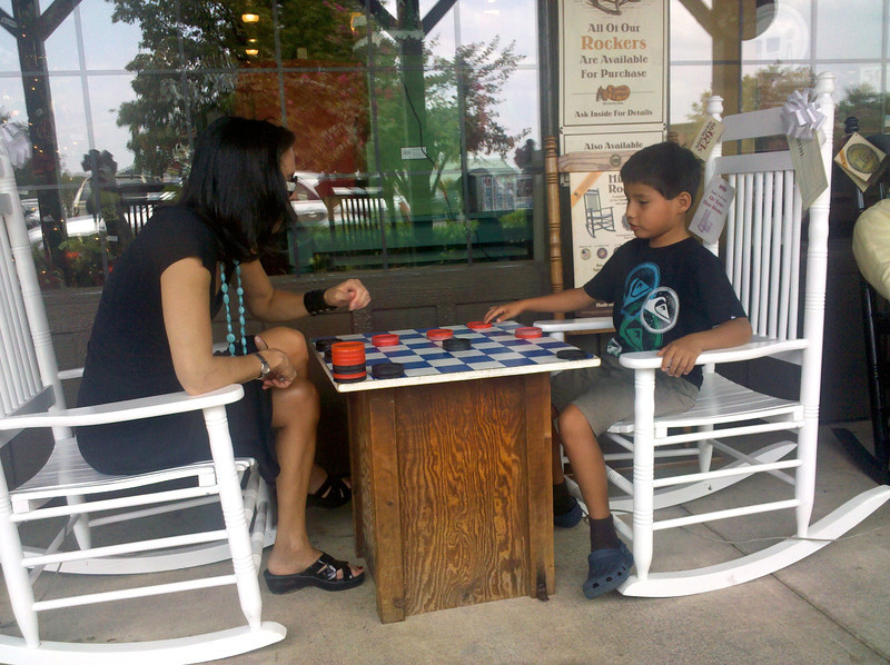 Daphne and Parker playing a checkers game as we waited at the Cracker Barrell Restaurant in Lexington, NC, on Sunday, August 7, 2011.
