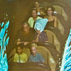 Snapshot of a monitor showing us riding Splash Mountain. Parker and Tace in front seat, Wynda and Parker next (Wynda with a plastic bag over her head!), Shawn and Daphne in next seat.