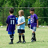 Parker (right) and Misha, his school friend and fellow soccer team member (center).
