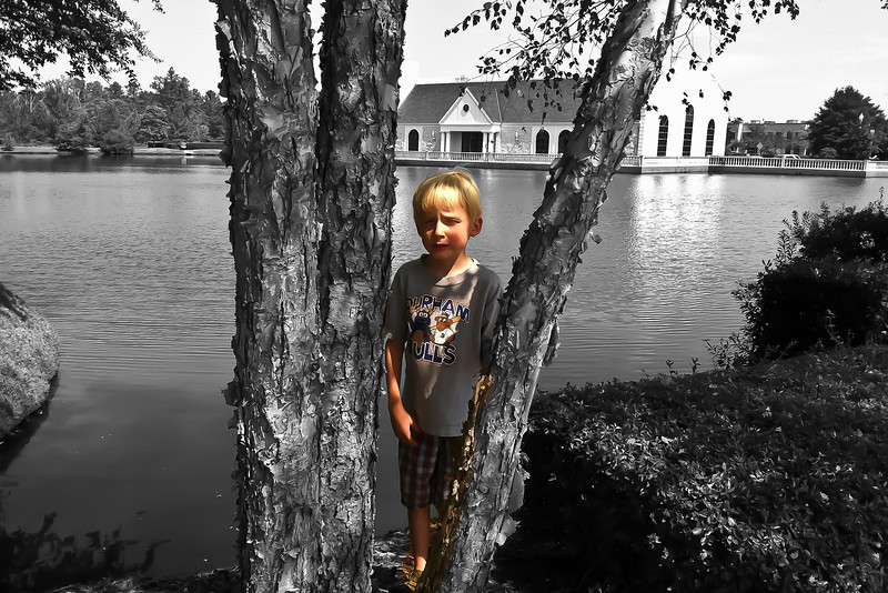 Taken with iPhone 4. Edited with ColorSplash app on the phone. Converted to B & W and then Cail's color brushed back in. Photo was taken on Sept. 14, 2011, while we waited for Wynda to see her doctor. Sharpened in Lightroom 3.