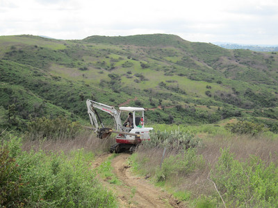 Transporting steel stringer down Yucca trail to bridge site