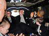 Ian tries to escape the camera, but space was tight in that limo!