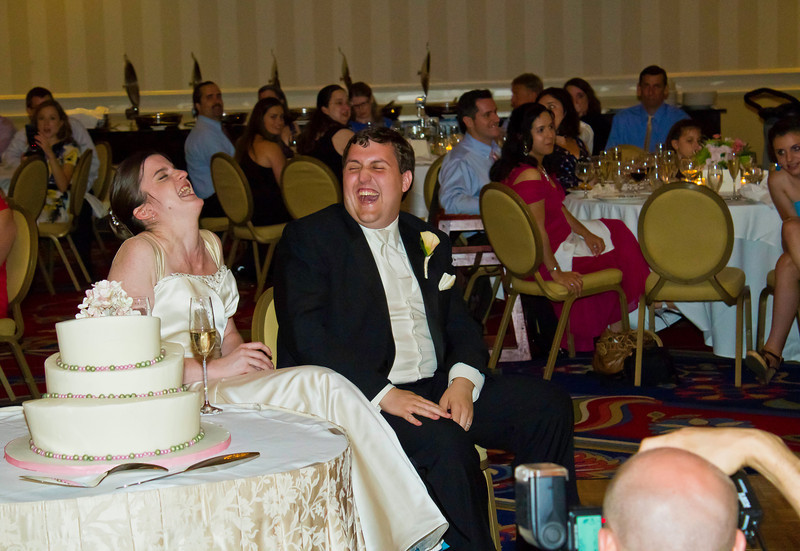 The bride and groom get a kick out of Eric's comments.