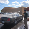 Cleaning the car outside the hotel in Colorado Springs after the 1200 mile drive from Houston.