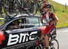 Ivan Santaromita loads up with bottles for Evans and BMC - but their VIP guest for the day is fast asleep in the back seat..!