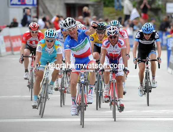 Thomas Voeckler celebrates Kern's victory while taking 3rd-place...