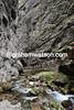 The peloton squeezes through the Malga Chapele gorge halfway up the Passo Marmolada...