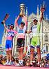 Alberto Contador poses with Michele Scarponi and Vincenzo Nibali on the podium in the Piazza Duomo in Milan...