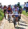 Mitchell Docker leads the day's early escape on to the Troisville cobblestones...