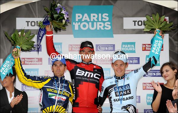 Greg Van Avermaet shares his winner's podium with Kasper Kloostergaard and Marco Mercado...