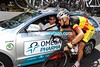 The new Belgium champion, Philippe Gilbert, is asking for the latest time-gap at his team car...