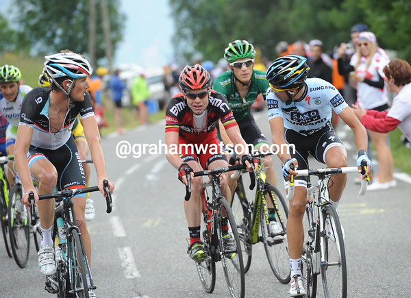 Frank Schleck and Alberto Contador look back at Evans as another move fails...