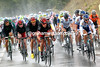 BMC start to wind up the chase pace in the pouring rain...