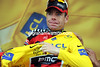 Cadel Evans looks stunned as he puts on the Yellow Jersey..!
