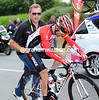 Bruyneel is still smiling as he pushes Leipheimer back on to the road - did he really lose his team-leader in yesterday's crash..?!