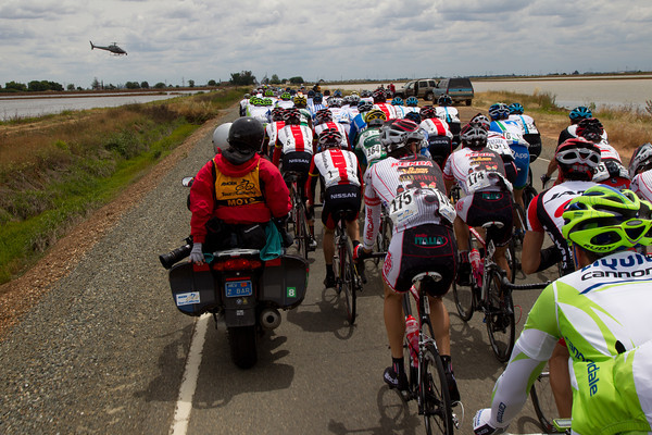The roads narrow as the peloton passes between flooded rice fields outside of Sacramento.