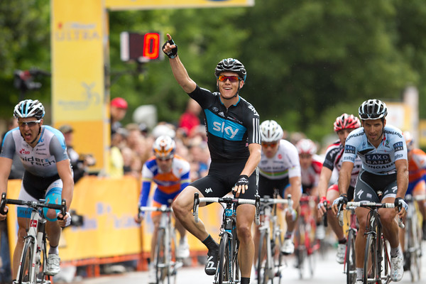 Ben Swift of Sky has won stage two over Sagan and Goss as the rain falls.