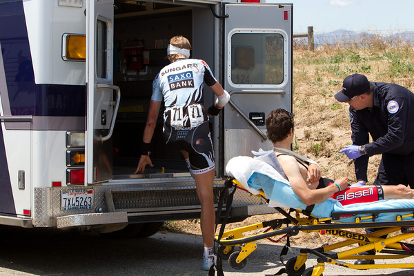 But the pace of the peloton is causing some issues in the peloton. Gustave Larsson and Ben Jacques-Maynes get into an ambulance after crashing just after a narrow bridge.