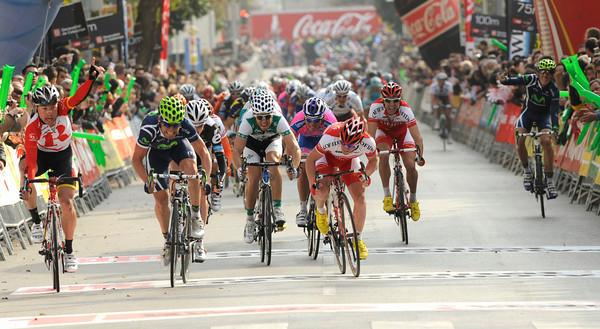 Cardoso, on the left, appeals against the sprinting of a Movistar rider...