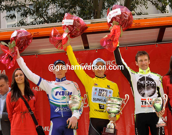 A multinational podium in Murcia sees Alberto Contador celebrating with Jerome Coppel and Denis Menchov...