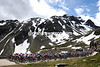 The peloton is almost at the summit of the Nufenenpass, all 2,100-metres of it...