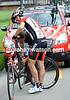 Phillip Deignan gets a wheel change from World & Olympic champion, car driver and now mechanic, Viatcheslav Ekimov...