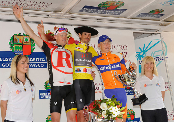 Andreas Kloden shares his winner's podium with Chris Horner and Robert Gesink...