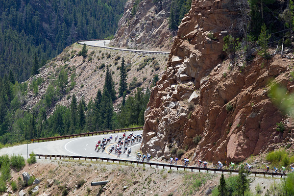 The peloton is in full flght on the descent after topping eleven thousand feet.