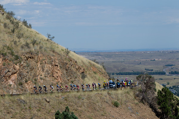 Just sixteen riders remain as the lead group approaches the summit.